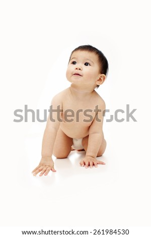 1 year old baby naked with diaper is crawling and not looking at the camera, isolated on white   - stock photo