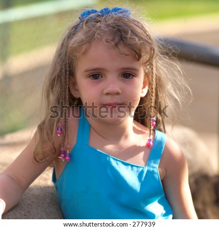 4 - 5 year old blond girl looking at camera