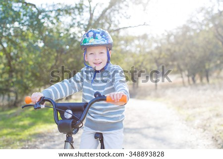 6-year old boy biking in the park - stock photo