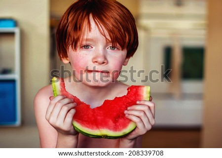 7 year old boy eating watermelon -- image taken in Reno, Nevada, USA