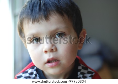 3-year-old boy looking into camera, beautiful in black and white also. Very shallow depth-of-field