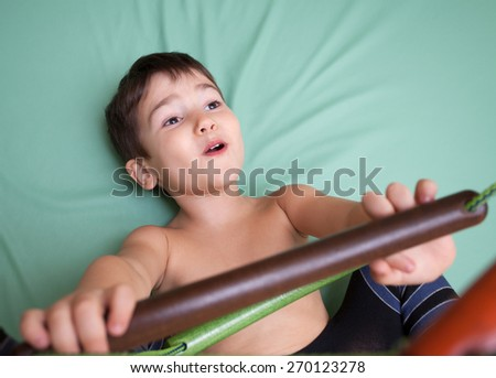 3 year old child at home sport gym - stock photo