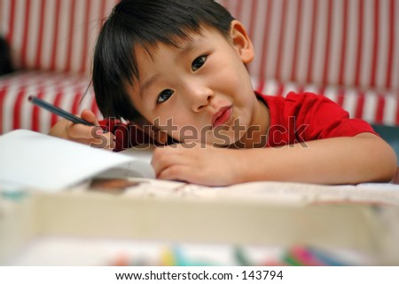 5-year old Chinese boy, learning to write - stock photo