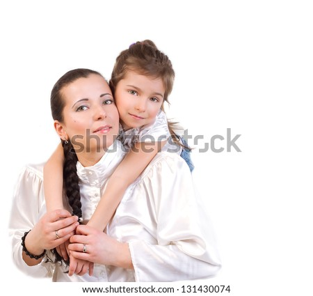 5 year old daughter in a white dress gently hugs his mom. isolate - stock photo
