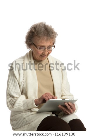 80 Year Old Elderly Senior Texting on Tablet Computer Isolated on White Background - stock photo