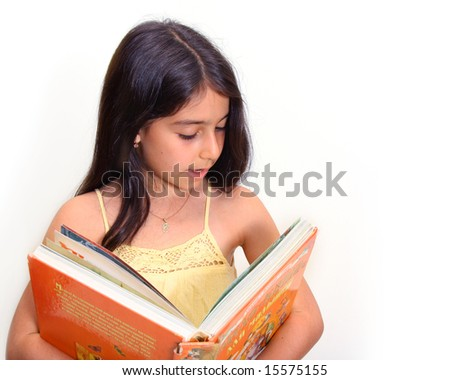8 year old girl holding a large book