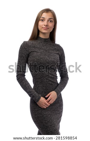 20-year-old girl in a gray dress in the studio. Isolate on white. - stock photo