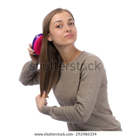 20 year old girl is combed in the studio, isolate on white. - stock photo
