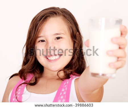 10 year old girl offering a glass of milk