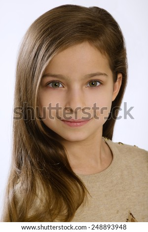 7 year old girl on a white background - stock photo