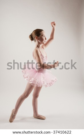 7 year old girl practicing ballet in tutu  MR - stock photo