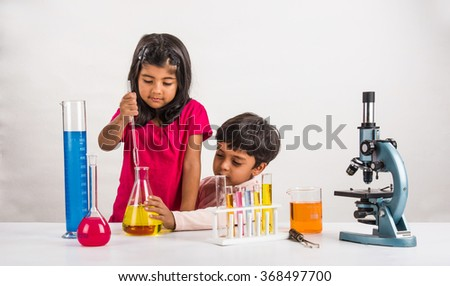4 year old indian boy and girl doing science experiment, science Education. asian kids and science experiments, chemistry experiment, indian kids and science experiments, indian kids and science lab