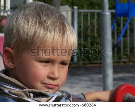 4 year old relaxing in the playground - stock photo