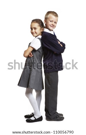 8 year old school boy and girl stood back to back on white background - stock photo