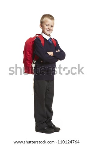 8 year old school boy arms folded with backpack on white background - stock photo