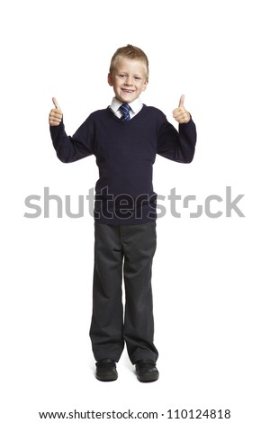 8 year old school boy with thumbs up on white background - stock photo