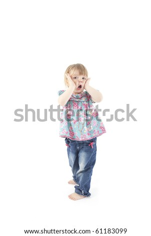 2 year old toddler pulling a funny face on isolated white background