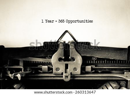 1 year = 365 opportunities, motivational message typed on vintage typewriter