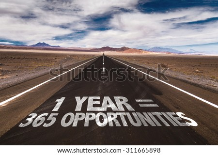 1 Year = 365 Opportunities written on desert road - stock photo