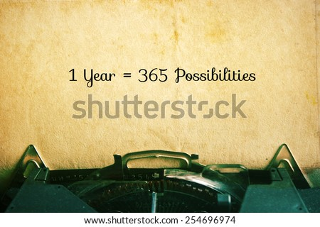1 Year = 365 Possibilities: Inspiration Motivational Quotes on Vintage Paper Background. - stock photo