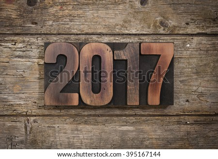 2017, year set with vintage letterpress printing blocks on rustic wooden background - stock photo