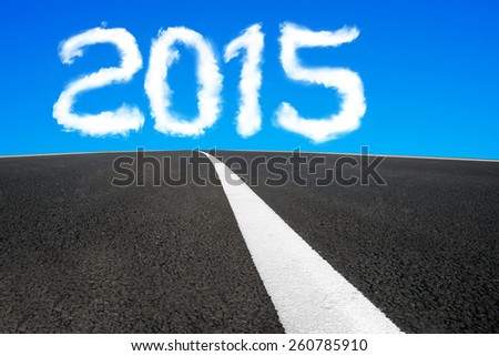2015 year shape cloud in the blue sky with asphalt road and separation white line background - stock photo
