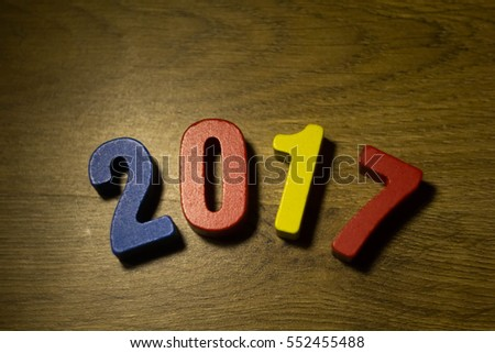 2017 year text wood on modern wooden on wooden background