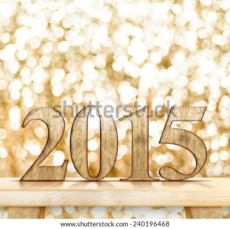 2015 year wood number  on modern wooden table with sparkling bokeh light wall,Template that leave space for your content - stock photo