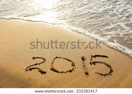 2015 year written on sandy beach