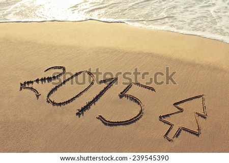 2015 year written on sandy beach. Toned image - stock photo