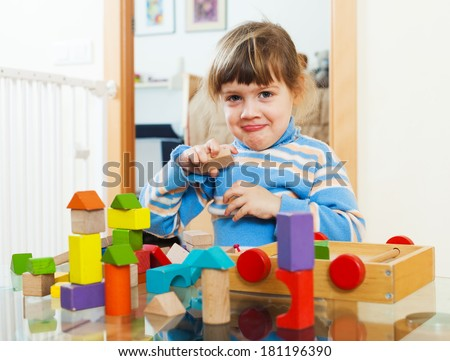 3 years child playing with toys in home interior - stock photo