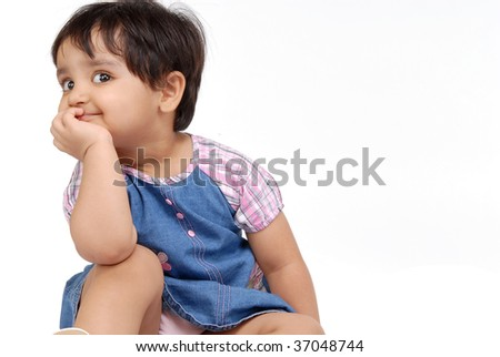 2-3 years old baby girl thinking over white background - stock photo