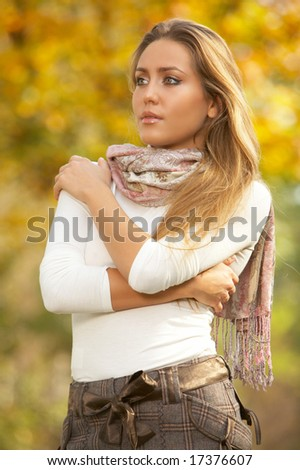 20-25 years old beautiful sexy woman portrait in natural autumn outdoors