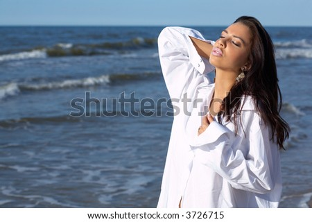 20-25 years old Beautiful Woman on the beach, wearing shirt
