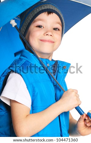 5 years old boy holding blue umbrella