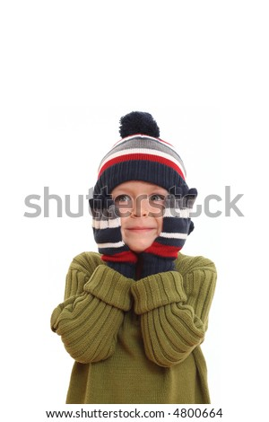 5-6 years old boy in hat and gloves - winter portrait