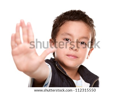 7 years old boy making a stop signal with his hand - stock photo