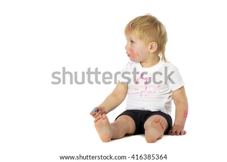 5 years old boy playing with paint, isolated on white
