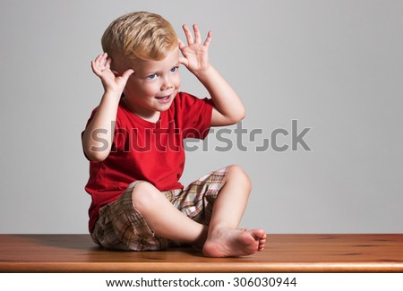 3 years old boy. Showing funny gesture. 10 fingers - stock photo