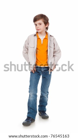 7 years old boy standing on a white background - stock photo