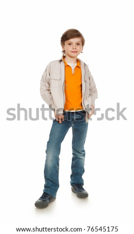 7 years old boy standing on a white background