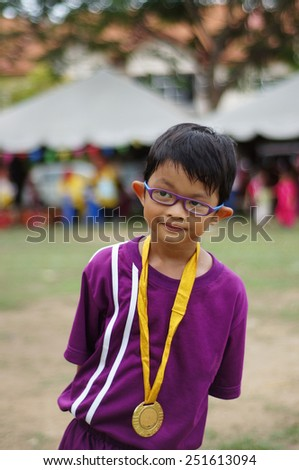 6 years old boy with his winning medal - stock photo