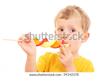 4-5 years old boy with lollipop on white - kids