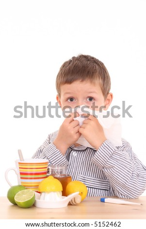 5-6 years old boy with thermometer and cold and flu remedy - stock photo