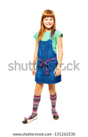 8 years old Caucasian girl with long hair standing isolated on white full height portrait - stock photo