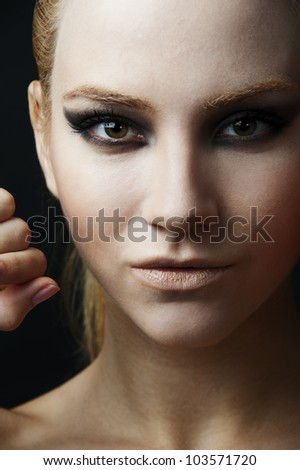 18 years old fashion female model at black background