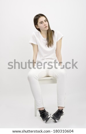 20 years old female fashion model wearing white clothes against white background high key  - stock photo