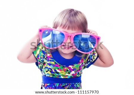 3 years old funny girl wearing colorful glasses isolated over white background - stock photo