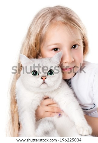 7-8 years old girl holding white cat - stock photo