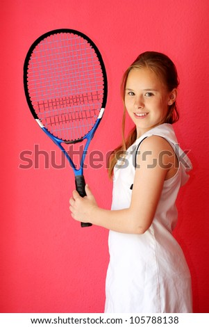 13-years old girl tennis player with racket - stock photo
